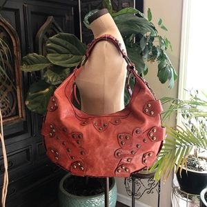 Isabella Fiore Oasis rust red studded hobo bag